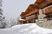 Ski resort hotel in the snow — Stock Photo