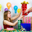 Birthday. The girl accepts gifts — Stock Photo