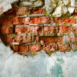 The destruction of a brick wall — Stockfoto
