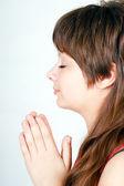 Ger girl folded her hands in prayer — Stock Photo