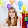 Happy birthday. Attractive young girl with gifts — Stock Photo