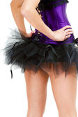 Sexy young girl in a skirt and corset. View from the back — Stock Photo