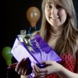 Stock Photo: Smiling girl with gift box