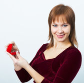 Young attractive woman with a box for rings — Stock Photo