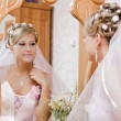 Bride looks in the mirror — Stock Photo