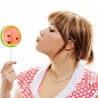 Attractive girl with a round lollipop — Stock Photo