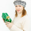 Charming smiling girl holding a gift box — Stock Photo #35219433