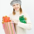 Charming smiling girl holding a gift box — Stock Photo #35219465