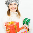 Charming smiling girl holding a gift box — Stock Photo #35219493