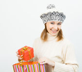 Charming smiling girl holding a gift box — Stock Photo