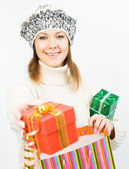 Charming smiling girl holding a gift box — Foto Stock