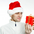 Man in a Santa hat with Christmas gift — Stock Photo