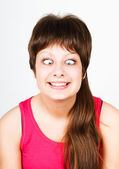 Cross eyed squinting expression girl — Stock Photo