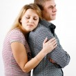 Stock Photo: Young womhugging man