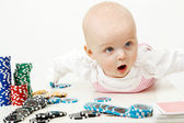 Baby playing with chips — Stock Photo