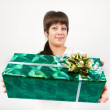 Young womwith packaged gift — Stockfoto #39714277