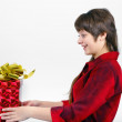 Young womwith packaged gift — Stock Photo #39714335