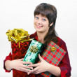 图库照片: Young womwith packaged gifts