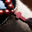 Wooden rosary with a cross — Stock Photo