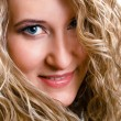 Portrait of a beautiful young girl with long blond wavy hair — Stock Photo #45114545