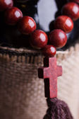 Wooden rosary with cross — Stock Photo