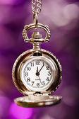 Silver retro clock on a festive purple background — Photo