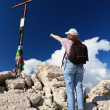 Hiker pointing the cross — Stock Photo