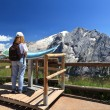 Hiker looks panorama — Stock Photo