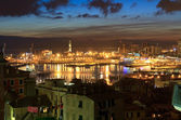Genova and the port at evening — Stock Photo
