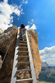 Hiker on wooden staircase — Stock Photo