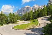 Winding road to Pordoi pass — Stock Photo