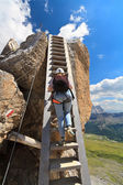 Hiker on wooden ladder — Stock Photo