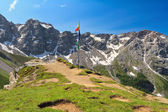Dolomiti - panoramic point with flags — Stock Photo