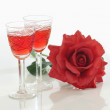 Two glasses and red rose — Stock Photo #1429797