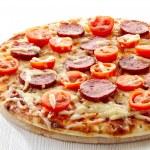 Salami and tomato pizza — Stock Photo