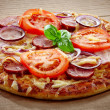 Salami and tomato pizza - Stockfoto