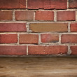 Old brick wall and wooden flor — Stock Photo