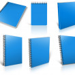 Stock Photo: Six blue spiral blank notepad on white.