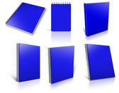Six blue spiral blank notepad on white. — Stockfoto