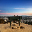 Two sitting on a bench overlooking the city of Los Angele — Stock Photo