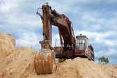 Dredge on a heap of sand — Stock Photo