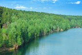 Lake in wood open-cast mine — Стоковое фото