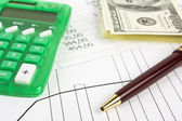 Financial report with pen — Stock Photo