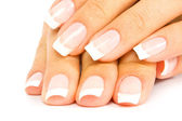 Care for sensuality woman nails — Stock Photo