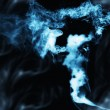 Stock Photo: Smoke on the black background