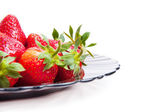 Strawberry in bowl isolated on white — Stock Photo