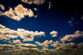 Blue sky with white clouds background — Photo
