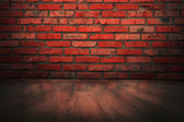 Brick wall and wooden floor background — Stock Photo