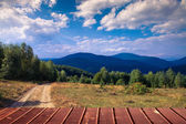 Empty wooden terrace with mountain landscape — Stock Photo