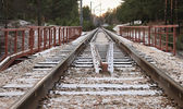 Railway under a thin layer of the first snow. — Photo